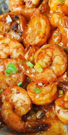 Spicy Cajun Shrimp with Sauce. Made with garlic, ketchup, chicken broth, hot sauce, Cajun spice, and green onions. Super easy to make – 30 minutes from start to finish! Southern comfort food!
