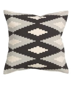 Cushion cover in woven cotton fabric with a printed design at front and solid color at back. Concealed zip. Size 16 x 16 in.