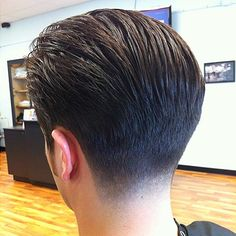 Aggressive taper with significant length on the back and sides. NOT an easy haircut to do but it sure looks good!