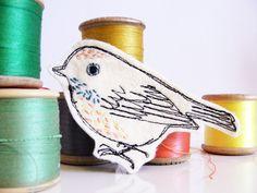 Machine embroidered bird