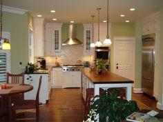 White kitchen with honed granite and mahogany