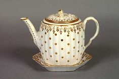 A Worcester Porcelain Teapot, Derby cover, Caughley stand 18th/19th century.