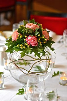 round centerpiece would compliment round tables - wedding recption decor - table centerpiece goldfish bowl bouquet