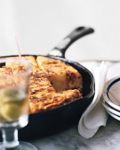 Tortilla Espanola with Chorizo. Diced chorizo contributes a spicy note to this classic egg dish with potatoes and onion.