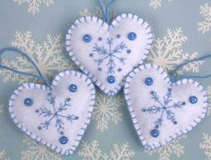 Felt Christmas heart ornaments,Handmade blue and white snowflake hearts,3 Scandinavian embroidered heart decorations,felt tree ornaments by PuffinPatchwork on Etsy https://www.etsy.com/listing/116048564/felt-christmas-heart-ornamentshandmade