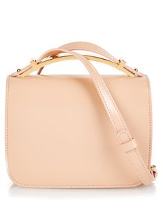 Marni's compact Sculpture cross-body bag arrives in a nude-pink hue for the new season.It's crafted in Italy from high-shine leather and is detailed with an adjustable shoulder strap and gold-tone metal top handle. Contrast it against a boldly patterned dress. | Available at MATCHESFASHION.COM