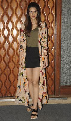 Kriti Sanon in an ASOS T-Shirt, Madison skirt, Shivan & Narresh trench, and Tresmode sandals