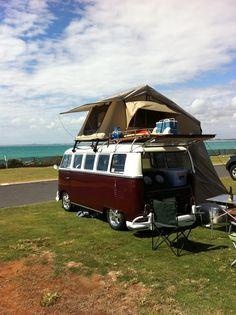 Camping , splitty style. VW Camper van bus and awning