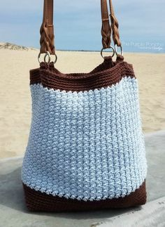Crochet Bags Pattern The Driftwood Tote Bag is a simple design with modern impact. An easy pattern repeat makes this a perfect project to enjoy without a lot of fuss. The texture made in the body of the bag is gorgeous. Find the Free Crochet Pattern at Crochet Vintage, Modern Crochet, Crochet Round, Crochet Shell Stitch, Bead Crochet, Crochet Hooks, Crochet Handbags, Crochet Purses, Crochet Beach Bags