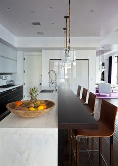 """I like how they used wood for the countertop on the seating side.  Also, love the """"Waterfall"""" island."""