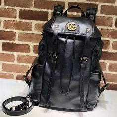 Gucci RE(BELLE) Leather Backpack x x leatherBrass hardwareTwo side pocketsBlack mesh backInterior zipper pocket and two smartphone pocketsFlap with adjustable buckle closuresMicrofiber lining with a su Gucci Handbags Outlet, Gucci Bags, Black Gucci Purse, Gucci 2018, Designer Bags For Less, Bag Sale, Leather Backpack, Backpacks, Man Bags