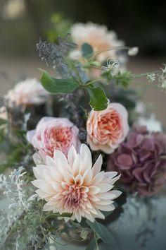 dahlia and garden rose arrangement - photo by White Willow Photography http://ruffledblog.com/sail-away-with-me-wedding-editorial #flowers #dahlias