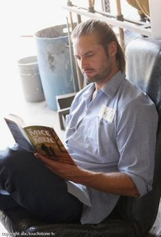 Few things are hotter than a man reading a good book.