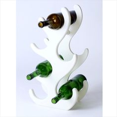 "Bar Accessories, The Walnut, The Marine Plant (Rack) for Rs.2800  Nothing says contemporary like this white wooden rack. Inspired by underwater sea plants, makes for a great center-piece. Can hold 6 bottles of 3.5"" diameter or less. Finish: Ceramic white. Dimensions: L 10.25 x B 6 x H 19.75 inches"