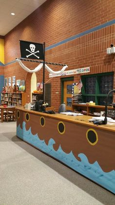 t-shirt desk minus the pirate ship Pirate Halloween, Pirate Day, Pirate Birthday, Pirate Theme, Pirate Flags, Vbs Themes, School Themes, School Library Themes, School Libraries