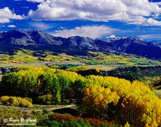 A view from Last Dollar Road toward the valley where Telluride is located during peak fall colors