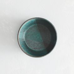 Wheel thrown speckled clay dish with textured teal glazes4.5in. diameter x 1.25in. tallFood safe. Hand washing recommended.