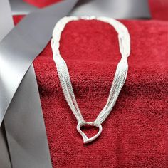 The necklace features a lobster clasp that makes it easy to put on and take off. The lobster clasp ensures that the necklace will not come loose when you are wearing it. Valentine Gifts For Girlfriend, Heart Shaped Necklace, Anniversary Gift For Her, Online Gifts, Heart Shapes, Birthday Gifts, Gifts For Her, Best Gifts, Lobster Clasp