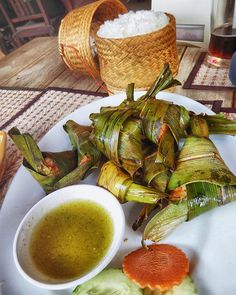 Chicken wrapped in pandan leaves with sticky rice. A taste sensation. #vientiane #laos #laofood #tastetravel #tastetravelfoodadventuretours #sunshinecoast #australia #holiday #vacation #tour #travel #traveler #instafood #instagood #cooking #cookingclass #food #foodie #foodlover #foodtour #foodietravel #sightseeing #delicious #yum #restaurant #cafe #streetfood