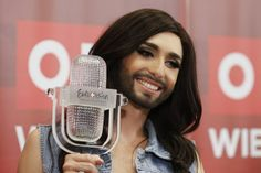 Upon her jubilant return to Vienna, Conchita pledged to promote tolerance. | Russians Are Shaving Their Beards In Reaction To Conchita Wurst's Eurovision Win