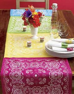 Simple table runner - perfect for a summer party. Sew (or no sew tape) dollar shop bandanas together. Uploaded from The Cottage House (Facebook page)