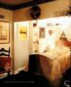 This ghost photo was taken in 1999 at Historic Worley B Inn in Dahlonega, Georgia. The owners hired a photographer to take publicity photos of the inn and its rooms. One contained the faint image of the upper portion of a man lying on the bed. The Inn's owners believe the figure may be the ghost of Claude Worley. A descendant of Captain William Jasper, he reportedly died in the house in 1889 after being hit by a train.