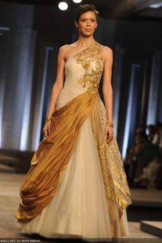 Sucheta Sharma showcases a creation by designers Shantanu and Nikhil on Day 1 of India Bridal Fashion Week, held in New Delhi, on July 23, 2013.