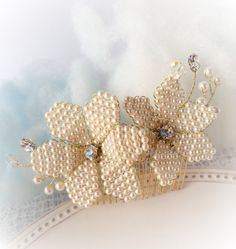 For an ethereal look with a modern edge, delicate bridal hair comb with 3 dimensional hand wired beaded flowers. Swarovski crystal stones in the center of each flower adds a sparkling finish to this beautifully handmade piece.