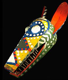 African Bozo mask, Seguo, Mali, puppet masquerade.  I like this mask as it looks like a rainbow.  I think it is a happy mask because it looks like it is smiling.
