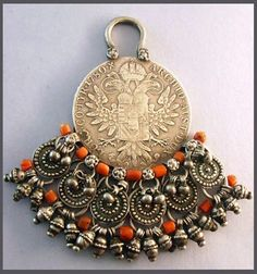 Yemen   Maria Theresa Thaler Pendant with antique Mediterranean coral and silver   ©Veronica Wainstein.