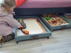 When we didn't need the changing table anymore, so I repurposed them into perfect under-bed-storage-drawers. They can even be used under the sofa!