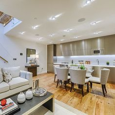 Open plan kitchen, dining and living room, residential development in Duck Lane, London