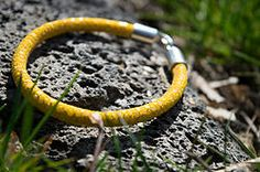 Yellow Stingray Leather Bracelet 63 USD. This bold stingray leather bracelet with rhodium-plated sterling silver Royal Lily clasp speaks for itself... You should only wear and admire it! #jewelry #leatherbracelet #phantom #stingraybracelet #silver #handcrafted #beautiful #bracelet #fashion #musthave #leather