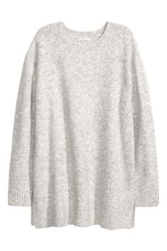 Knitted jumper: Oversized jumper knitted in marled yarn containing some wool with a round neck, dropped shoulders, long sleeves and slits in the sides.