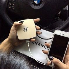 A Chanel inspired portable charger! This charger opens up and exposes a mirror on the inside.: