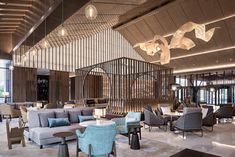 Architects Limited designed Hyatt Regency Beijing Shiyuan in Beijing, China. The hotel is designed to emulate green living, by blending into nature in Lobby Interior, Interior Design, Wood Truss, Lobby Lounge, Hotel Lobby, Lobby Bar, Natural Stone Flooring, White Industrial, Roof Design