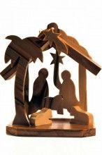 This is a unique Bethlehem Olive Wood 3D Miniature Hand-Carved Christmas Ornament showing the Holy Family in the stable with animals and the shadow of the star.  The ornament was made in Bethlehem from olive wood from the Holy Land.  It stands 2 1/2 inches high and may be used as a small nativity scene centerpiece or hung on the tree as a traditional Christmas ornament.