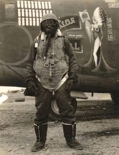 An airgunner stands before his B24 bomber wearing what it took to survive at 25,000ft over Germany in 1943-45