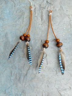 Homemade long brown leather earrings with blue feathers from a Jay by Liesbeth Visscher at JHFWBeadsAndFindings on #Etsy #jewelery #Jewelry