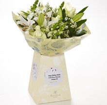 """A blooming bouquet of fresh, hand pieced blooms sets the scene for the dream birthday gift, complete with your loving words set among fluttering butterflies.  """"Happy Birthday"""" will be printed on the label alongside your personal message."""