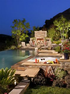 Poolside outdoor fireplace lounge area. WOW.