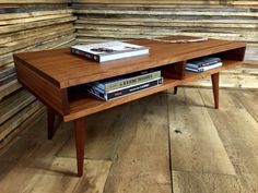 boxer mid century modern coffee table with storage featuring sapele mahogany with tapered wood legs