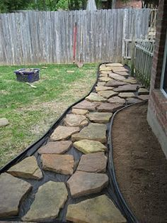 Instructions to make a rock walkway in backyard