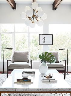 Serena & Lily Morrison Chandelier $2898 vs Visual Comfort Ian K Fowler Bistro Chandelier $1680 sunburst globe chandelier look for less copycatchic luxe living for less budget home decor and design daily finds and room redos