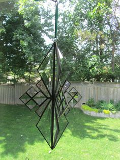 "4-Sided Stained Glass Star - Stained Glass Snowflake - Bevels - Iridized Glass - Measures 10"" tall"