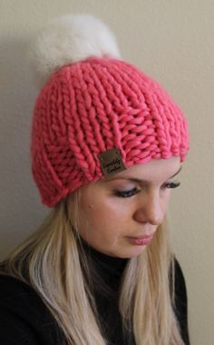 b985596e771 Woman s Bright Pink Hat With a Fur Pom Pom
