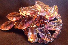 A Vintage Rhinestone Brooch is unsigned, created in the 1960s. This beautiful piece of costume jewelry of large and small Lavender Rhinestones