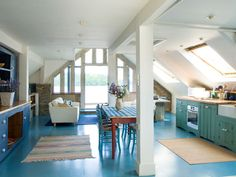Awesome attic studio space. LOVE the painted blue floors.