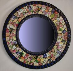 Lots of beautiful mosaic mirrors at this site.