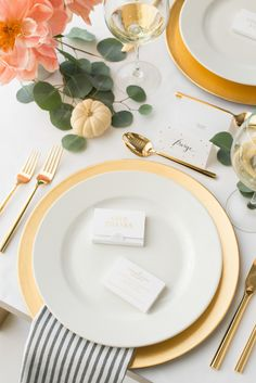 A simple and elegant table designed by Sugar Paper using striped napkins, gold accents, pink flowers, white pumpkins and eucalyptus. On each place setting is a white GIVE Thanks box filled with questions to promote connection and foster a more mindful celebration.